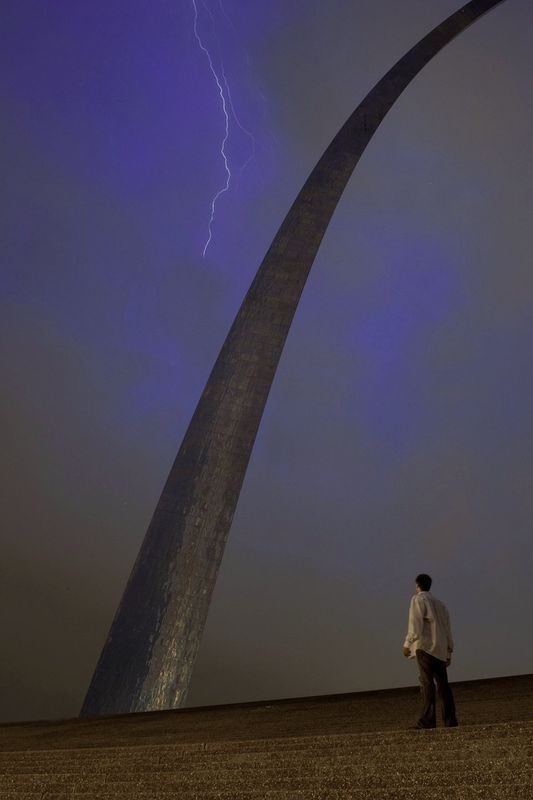 This was shot in a storm that moved through St. Louis earlier this year.  I positioned my D700 on a tripod and triggered it remotely while standing very still.  24-70mm 2.8 @ 24mm 25 second exposure Did not get struck...