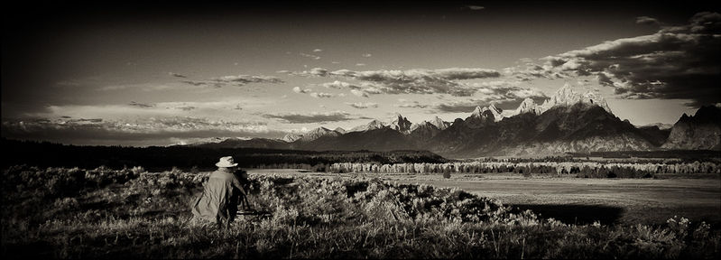 Image of Stephen Dohrmann (Steve D) taken as he photographs morning light on the Grand Tetons with the Snake River valley in front.