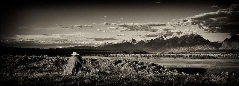Image of Stephen Dohrmann (Steve D) taken as he photographs morning light on the Grand Tetons with the Snake River valley in front.