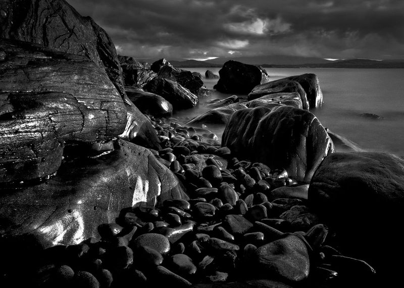 Late afternoon light on rocks at Low Head, Northern Tasmania, Australia. Raw conversion in Lightroom, further processing in PS CS4.