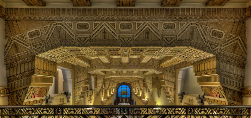 In 1930, The Marine Building in Vancouver, Canada was the tallest building in the British Commonwealth. The Interiors are one of the best examples of Art Deco Architecture anywhere. With very limited internal ambient lighting, the challenge was to show the level of detail and original interior colors in a way that would realistically document the roof beams of the main lobby. The photo was taken from the mezzanine using a D3 with a 14-24mm lens set at 14mm. The almost perfect rectilinearity of the image is a testament to the lens design. The aperture was set to f/11 for a healthy depth of field and the ISO was set to 800. 9 images were auto bracketed at 1EV apart. 5 images were used, each with a 2EV separation for the final HDR. No filters were used so as not to compromise the quality of the lens optics. I, of course, used a tripod and remote cable release. Using the internal levelling of the D3 was critical in achieving the final image. This image was shot very recently on October 24, 2011.