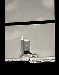 New_York_City_Window_with_Water_Tank_2010_SEP2_14x11.jpg