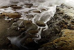 Receding_Water_on_Rocks_-_small.jpg