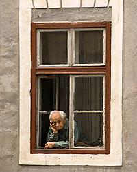 Man_at_Window_Sibiu_Romania.jpg