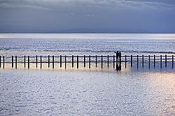 Couple_Standing_At_Marine_Lake_At_Dusk_C7P8045_1200w_.jpg