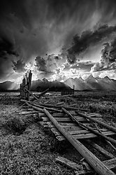 Fence_and_Storm_Near_the_Moulton_Barns.jpg