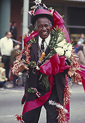 Man_w-flowers_at_parade.jpg