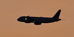 Airplane_at_sunset.jpg