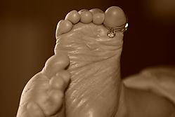 Baby_feet_with_Rings.jpg