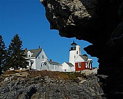 Lighthouse-frame-by-rocks.jpg