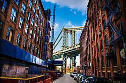 Manhattan_Bridge_Behind_Buildings_in_Dumbo_Light_Small_.jpg
