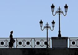 lady_crossing_bridge_at_nerac.jpg