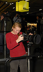 LND5516_-_Lady_concentrating_on_the_new_Nikon_D3.jpg