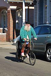 Old_man_on_a_bike.jpg